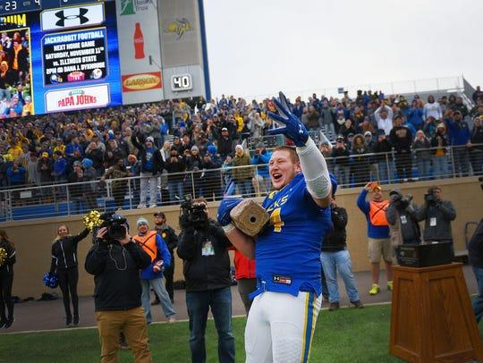 Kellen Soulek celebrates with the Dakota Marker last year in Brookings after SDSU's 33-21 win over NDSU.