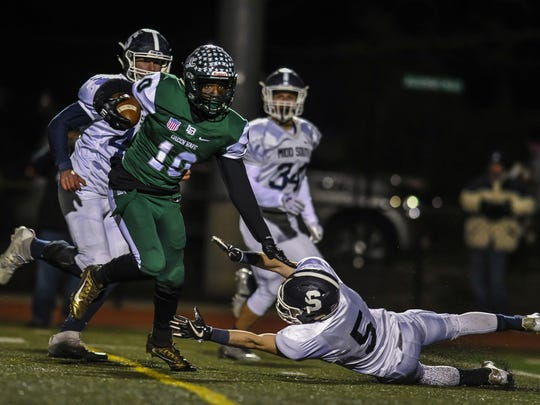 Long Branch's Marc Dennis makes a move to get past Middletown South's Jamie Petrillo during the NJSIAA Central Group IV football quarterfinal game in Long Branch on Nov. 10, 2017.  Jeff Granit/Correspondent