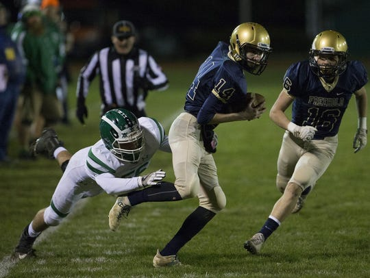 Freehold Boro's Jake Hurler catches a pass in flat