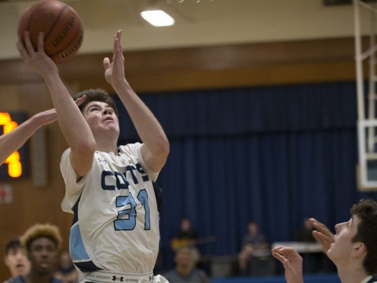 CBA junior guard Stephen Braunstein goes up for a shot