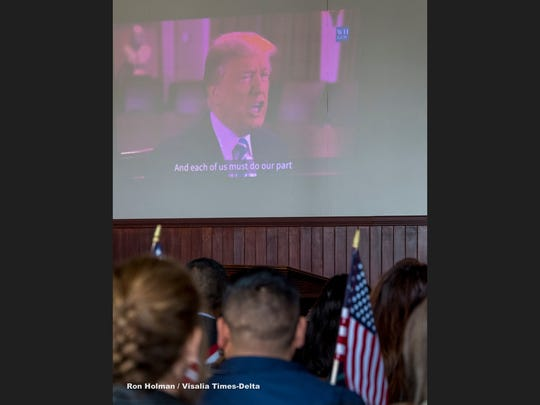 A video of President Donald Trump was played to welcome 32 immigrants from seven countries that became U.S. citizens Friday, February 2, 2018 during the Naturalization Ceremony at Colonel Allensworth Historic Park.