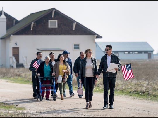 New citizen Salvador Aguire, right, and girlfriend Sandy De La Torre walk together after 32 immigrants from seven countries became U.S. citizens Friday, February 2, 2018 during the Naturalization Ceremony at Colonel Allensworth Historic Park.