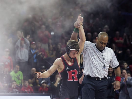 Rutgers' sophomore 125-pounder Nick Suriano, shown after he pinned a wrestler from Penn State on Jan. 28, advanced to the semifinals of the NCAA Tournament Friday morning.