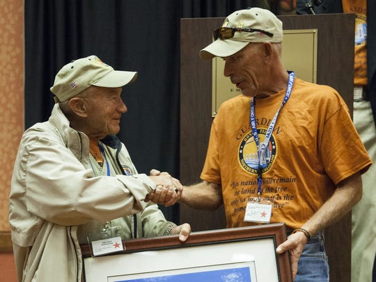In this 2015 photo, Stan Cass, commander of Honor Flight Northern Colorado, presents a thank-you gift to Charley Barnes, right, who road a motorcycle coast-to-coast to raise money for the program.