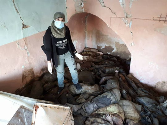 Sroor Al-Hosayni, 23, a nurse from Mosul, Iraq, leads