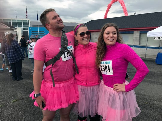 Brett Rowan (left) of Reno says he started taking part in Moms on the Run after his mother, Cindy Lain (middle) was diagnosed with cancer 11 years ago. Photo taken May 13, 2018.