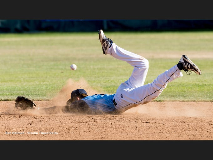 Redwood's Isaac Gonzalez goes after a hit ball from