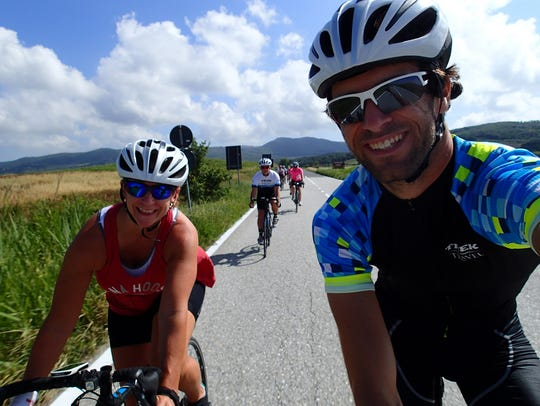 Lori Nickel and Trek Travel guide Pavel Drastik on Day 5 of the ride, headed to Volterra. Two guides were with the group of 17 riders; one on the road in his bike, the other driving the support van.