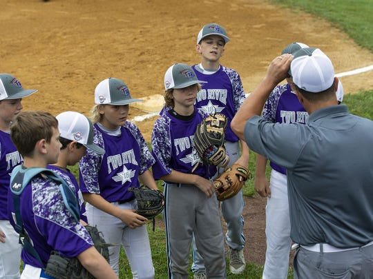 Two Rivers East Little League has a discussion while