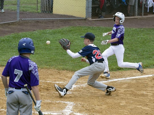 Two Rivers East's Nick Rigby scores to make it 6-0 in the fourth inning against Eatontown in a District 19 All Star game at Freehold Boro Little League field on June 23, 2018.