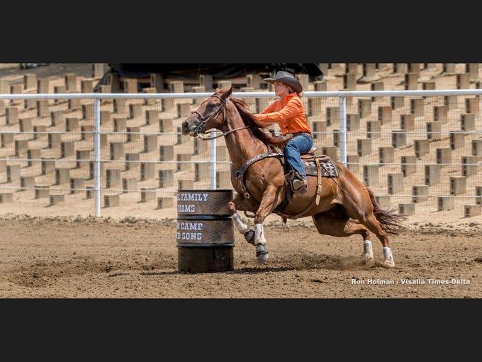 Lizzie Stewart competes with her horse Dennis in barrel