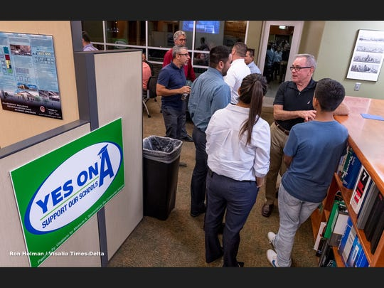 Visalia Unified School District board member John Crabtree (Area 4) talks with Measure A supporters in Visalia while waiting for election results during the 2018 Midterms on Tuesday, November 6, 2018.