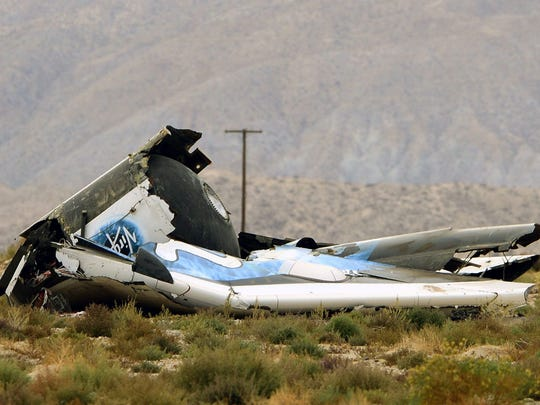 Debris from SpaceShipTwo rests in the Mojave desert.