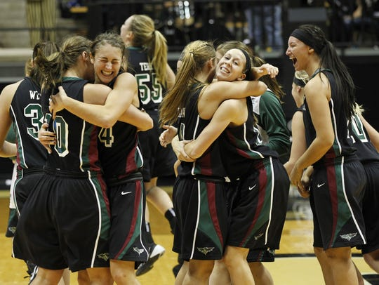 UWGB players celebrate after defeating Purdue 81-78