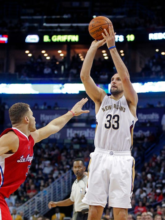 New Orleans Pelicans forward Ryan Anderson (33) shoots over Los Angeles Clippers forward Blake Griffin (32) during the second half of an NBA basketball game in New Orleans, Friday, Jan. 30, 2015. The Pelicans won 108-103. (AP Photo/Gerald Herbert)