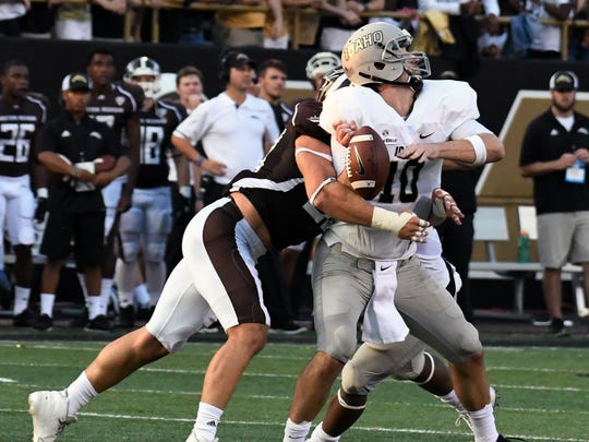 Western Michigan DL Antonio Balabani (58) gets a sack and forces a fumble that the Broncos recover in Idaho territory.