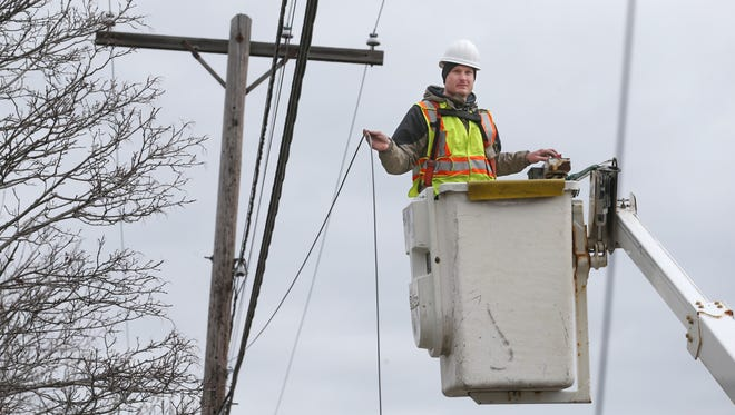 Ricky Herbst, working for Lantek Fiber Optic Service, a contractor for Greenlight Networks, runs a new 12 fiber that will help to increase customer capacity along Elmwood Avenue in Brighton Thursday, April 26, 2018.