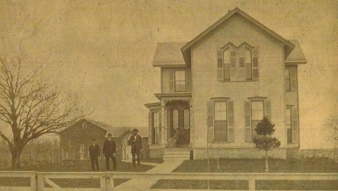 The farmhouse at 12 Mitchell Road was built in 1878; this photo was taken a few years later. Pictured are William and his wife, Maria, with their sons, 14-year-old Will and 11-year-old Charles.
