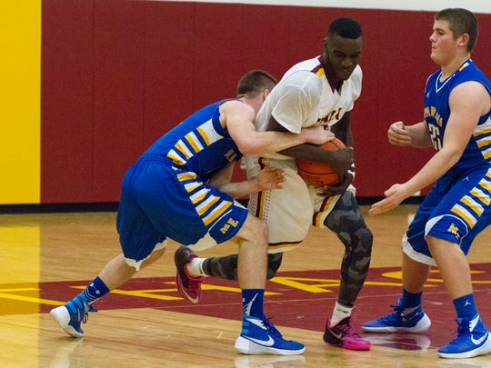 Ithaca center Darrell Davis rips the ball from a Maine-Endwell defender on Wednesday night.