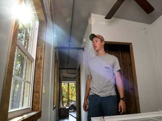 Tyler Wrenn, a sophomore at Clemson University, stands in the bedroom of his nearly completed tiny house in Pendleton.