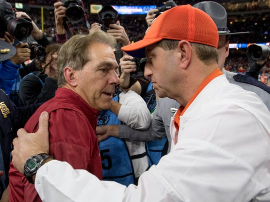 Alabama head coach Nick Saban and Clemson head coach Dabo Swinney  meet at midfield after the Sugar Bowl at the Superdome in New Orleans, La. on Monday January 1, 2018. (Mickey Welsh / Montgomery Advertiser)