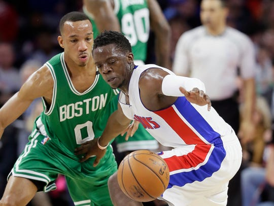 Pistons guard Reggie Jackson chases a loose ball while
