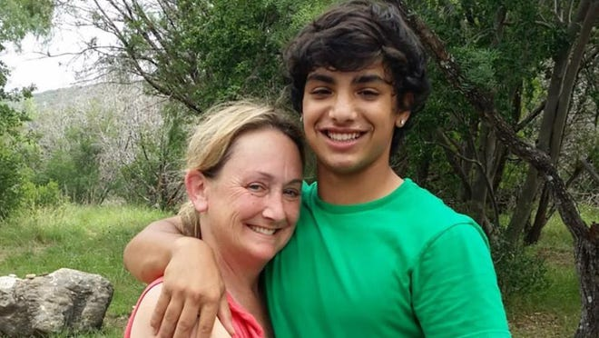 Zachary Anam poses with his mother, Kara Anam. After Zachary Anam was arrested in January 2017, he fatally shot himself in the back of an Austin police car while he was on the way to be booked. His parents are suing the city of Austin.