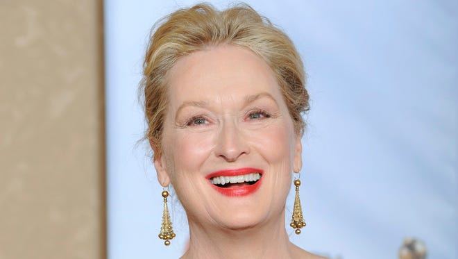 """Meryl Streep poses with the award for best actress in a motion picture, comedy or musical for """"Julie and Julia"""" backstage at the 67th Annual Golden Globe Awards on Sunday, Jan. 17, 2010, in Beverly Hills, Calif."""