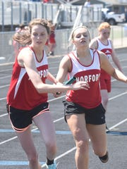 Norfork's Marleigh Dodson takes the baton from Whitlee
