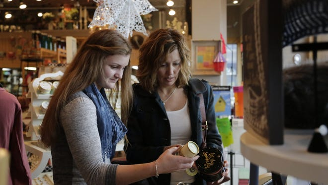 Debbie Siciliano (right) of West Lafayette and her daughter, Maria, (left) shop on Small Business Saturday, Nov. 28, 2015, at Interior Objects in Lafayette.