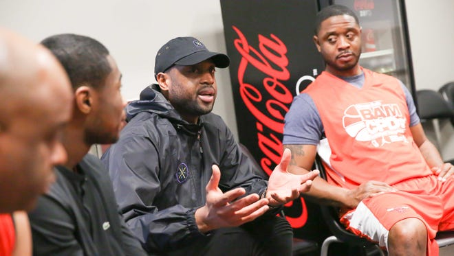 Chicago Bulls star Dwyane Wade participates in a conversation circle during the team's tournament for Chicago police officers and high school students.