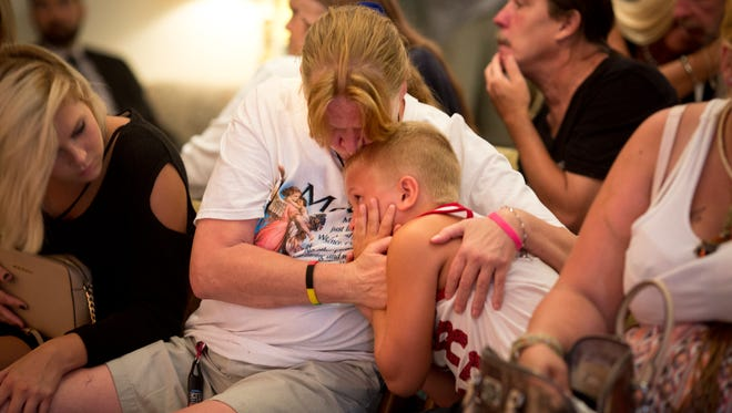 Mon., July 17, 2017: Covington. Kim Hill holds her grandson T.J. at her son's funeral in July. Tommy Burke died from an overdose while The Enquirer was reporting for the Seven Days of Heroin project. The Enquirer/Carrie Cochran