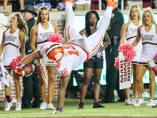 Clemson tight end Jordan Leggett (16) dives into the end zone as Florida State cheerleaders watch from the sidelines during the fourth quarter on Saturday at Doak Campbell Stadium in Tallahassee, Florida.