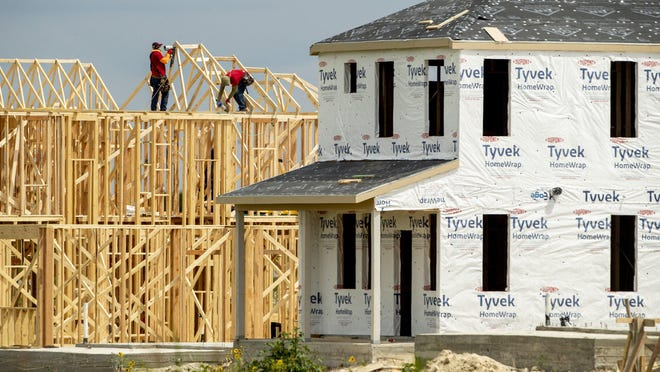 Construction crews work on a new home in the Easton Park neighborhood in Southeast Austin last month.  A lack of available homes on the market led to a 29.2% drop in sales in May, according to the Austin Board of Realtors.
