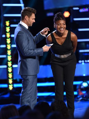 "Ryan Seacrest, left, breaks the news to Tyanna Jones that she has been eliminated from ""American Idol XIV"" Wed., April 29, on Fox."