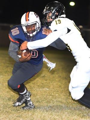 Leesville's Derek Hurt (19) tries to take down Beau Chene's Deontre Eaglin (10) during Friday's bi-district playoff game.