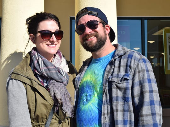 Sarah Casale and Brett Basehore hang outside a store