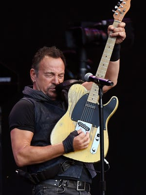 Bruce Springsteen beat his own record with a 3 hour, 59 minute concert in East Rutherford, N.J., on Tuesday.