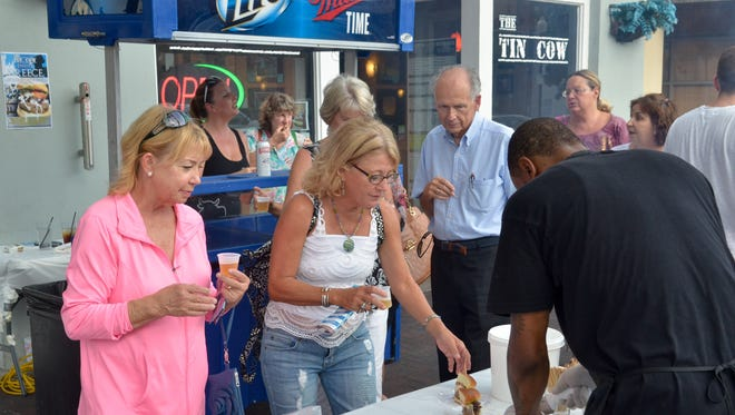 """The Tin Cow serves guests during a past Tastemakers event in downtown Pensacola. The """"restaurant crawl"""" returns Aug. 25-26."""