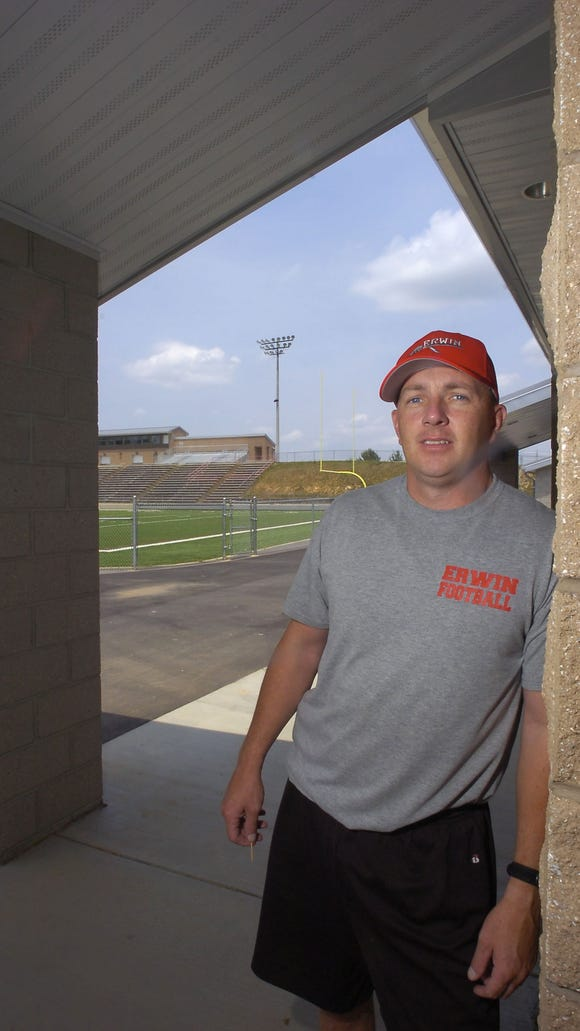 Former Erwin football coach Chris Brookshire has been hired at Smoky Mountain.