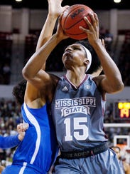 Mississippi State center Teaira McCowan (15) muscles