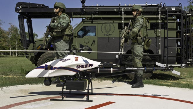 This September 2011 file photo provided by Vanguard Defense Industries, shows a ShadowHawk drone with Montgomery County, Texas SWAT team members.
