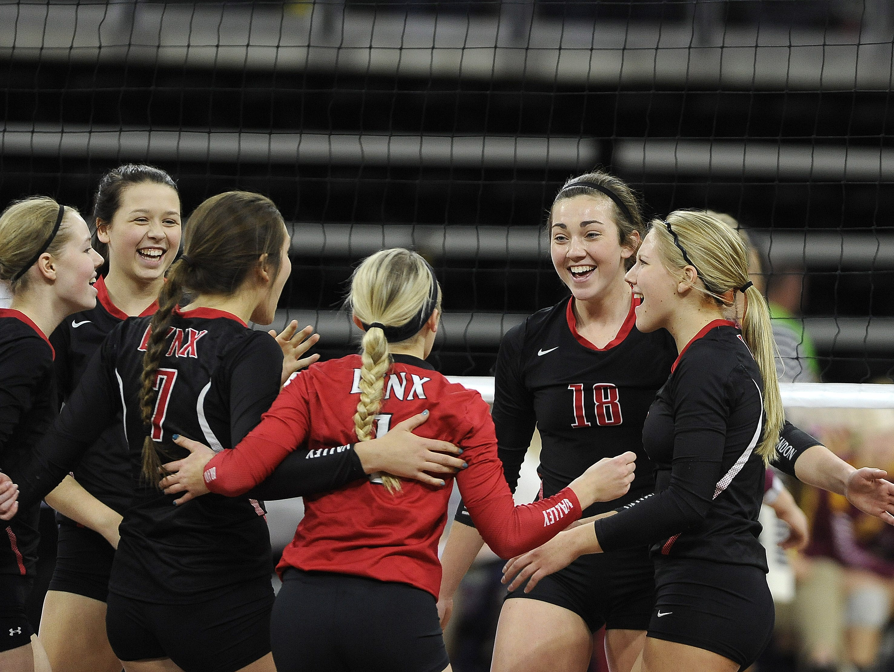 Brandon Valley celebrates scoring against Roosevelt during state volleyball action at the Denny Sanford Premier Center in Sioux Falls, S.D., Thursday, Nov. 19, 2015.