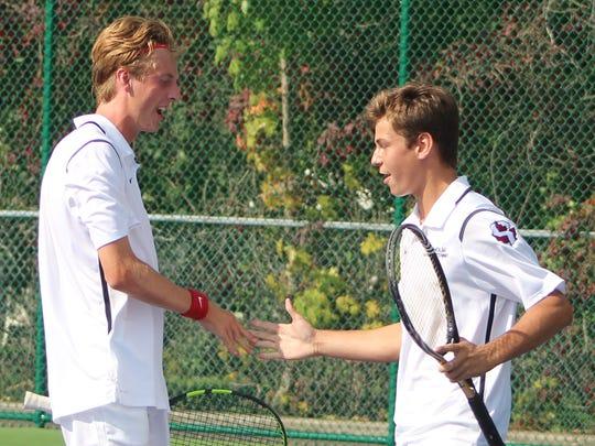 The No. 1 Seaholm doubles team of Nick Adams (left)
