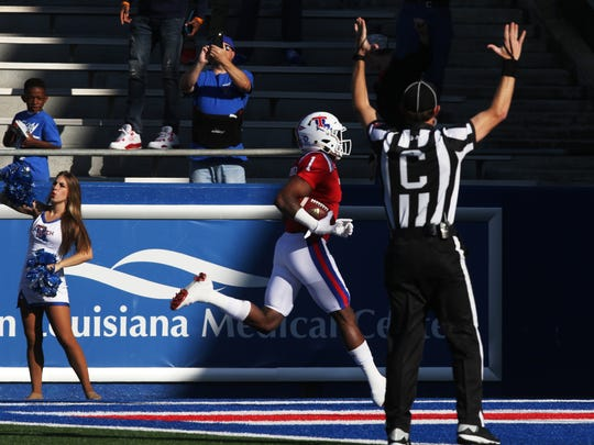 Louisiana Tech wide receiver Carlos Henderson scores
