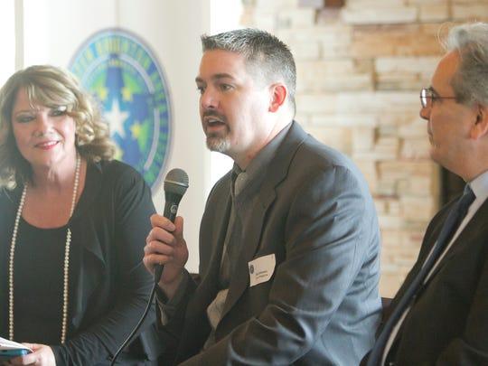 Brighton city manager Nate Geinzer speaks in a luncheon
