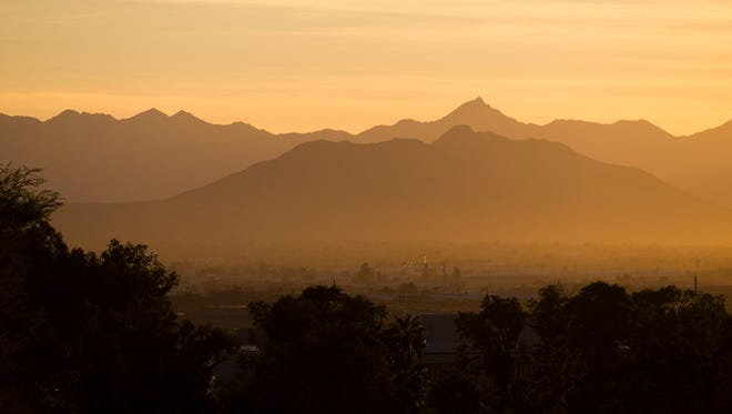 File photo: Pollution sits in the valley in south Phoenix during sunset November 24, 2014.