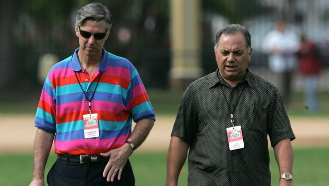 Detroit Tigers general manager Dave Dombrowski, left, and assistant GM Al Avila walk in Lakeland, Fla., in 2009.