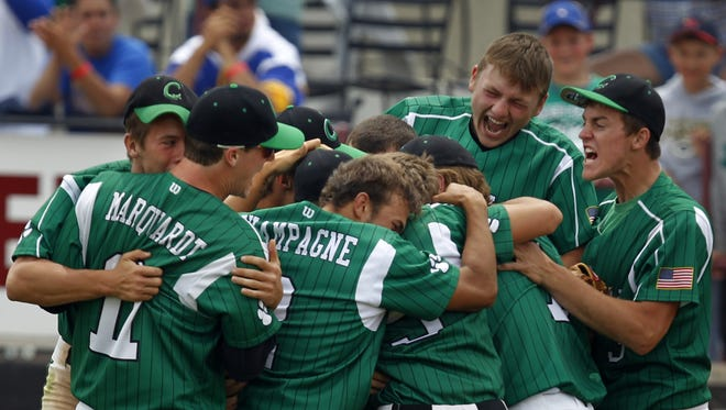Coleman High School players celebrate after winning the 2012 WIAA Division 4 state championship.