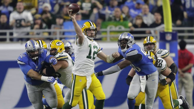 Green Bay Packers quarterback Aaron Rodgers passes against the Detroit Lions in the second quarter  Sunday, January 1, 2017, at Ford Field in Detroit.